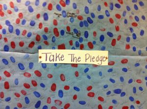 Pledge thumb prints by Lilly Milman