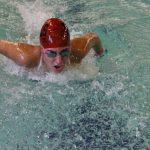 HIlls West Sophomore Kianna Cyrus swims the 100 Butterfly.