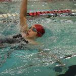 Hills West Senior Katie Lopez swims the 100 Back.