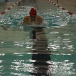 Hills West Sophomore Michelle Duffe swims in the 100 Breast.