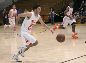 Josh Koval brings the ball up the court against Copaigue. Credit Ji Hoon Park