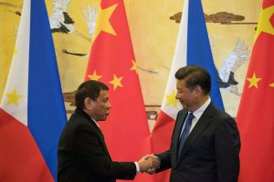 Duterte (left) shakes the hand of Chinese President Xi Jinping (Right)