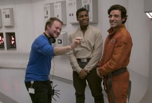 Star Wars: The Last Jedi..L to R: Director Rian Johnson on set with John Boyega (Finn) and Oscar Isaac (Poe Dameron)..Photo: David James..©2017 Lucasfilm Ltd. All Rights Reserved.